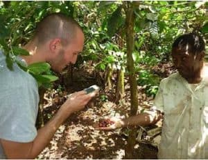 Picture of Aless andro Craparo registering coffee berries with smallholder farmers in Northern Tanzania.