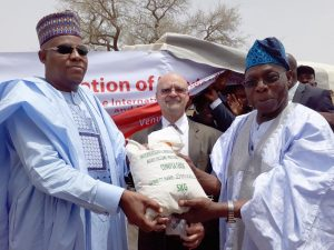 Picture of The Governor of Borno State, Alhaji Kashim Shettima; Deputy Director General, Partnerships for Delivery at IITA, Dr Kenton Dashiell; and IITA Ambassador and Former President of Nigeria, Chief Olusegun Obasanjo during the donation of 35,930 kilograms of seeds and 2640 kilograms of rice to Borno State government today (22 May 2017) in Maiduguri.