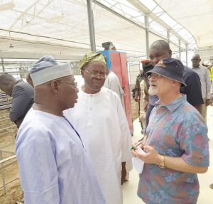 Picture of Chair of the Nigeria Zero Hunger Forum, Chief Obasanjo; Managing Director, Yintab Strategy Consults, Dr Babafemi Badejo, and Deputy Director General, Partnerships for Delivery, IITA, Dr Kenton Dashiell during a tour of facilities at the NZHF meeting in Borno.