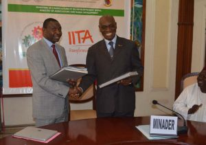 Picture of IITA Country Representative Cargele Masso and Minister Henri Eyebe Ayissi shaking hands after signing the agreement.