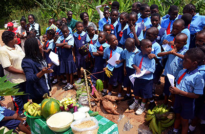 Starting them young: Youth trainer talks to pupils in a primary school in Nigeria about agriculture.