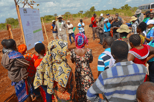 Dr Fidelis Myaka, Project Manager for the Building capacity for Resilient Food Security project explaining the CSA practices selected and being demonstrated at the demonstration plot at Kilimbili village, Morogoro.