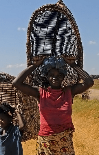 A woman and child going fishing using homemade baskets in Zambia